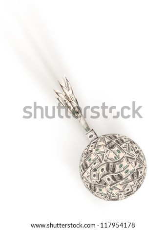 Financial crisis - an old bomb made of money falls down - stock photo
