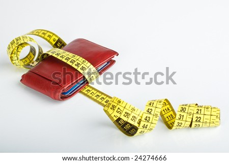 financial crisis concept, wallet with measuring tape - stock photo