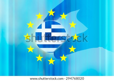 financial crisis in Greece and try to care by european union conceptual background with part of human hand  - stock photo