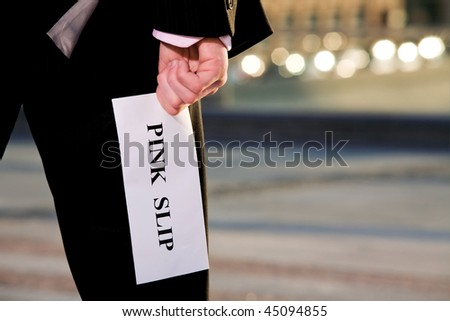 Financial crisis. Manager holding a job termination notice Pink Slip - stock photo