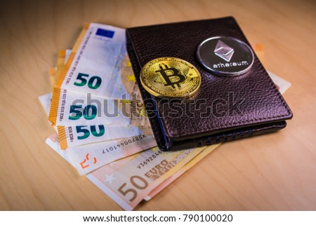Financial Cryptocoin Concept With Physical Bitcoin And Ethereum Over A Leather Wallet Euro Bills