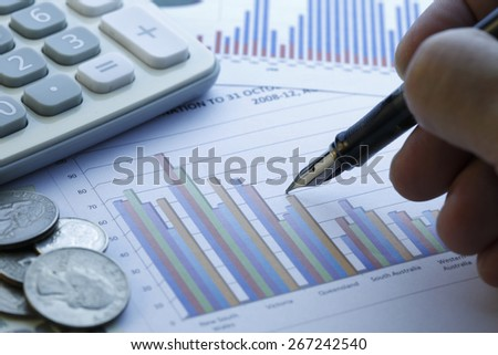 Financial data analyzing , shot with very shallow depth of field , blue tone - stock photo