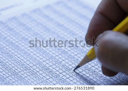 Financial data analyzing , shot with very shallow depth of field, blue toned - stock photo