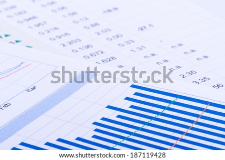 Financial data and bar chart graphs, business table. - stock photo