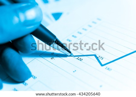Financial data on a digital monitor. Financial Trade Economics Financial Graphic Concept. Colorful financial background. Display of Financial data's Stock market quotes. Digital financial report.