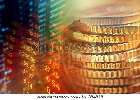 Financial data on a monitor and coins. Finance data concept. - stock photo