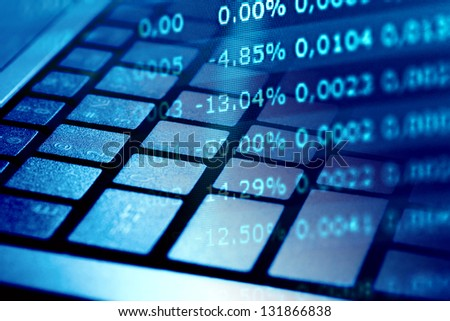 Financial data on a monitor and keyboard. Finance data concept. - stock photo