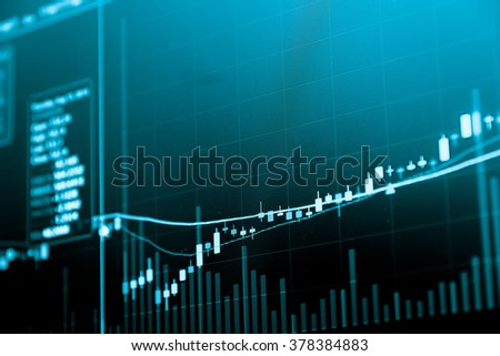 Financial data on a monitor. Business statistics and analytic, glowing sheet statistics of exchange trading in the dark. - business concept.