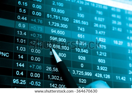 Financial data on a monitor. Business statistics and analytics, glowing sheet beznes statistics of exchange trading in the dark. - stock photo