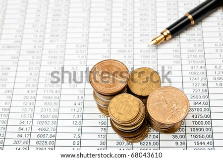 Financial document with numbers with coins stacks - stock photo