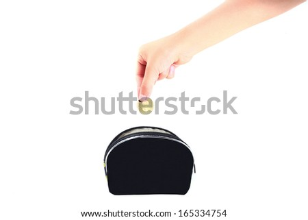 Financial education concept with child hands putting coins isolated on white background - stock photo