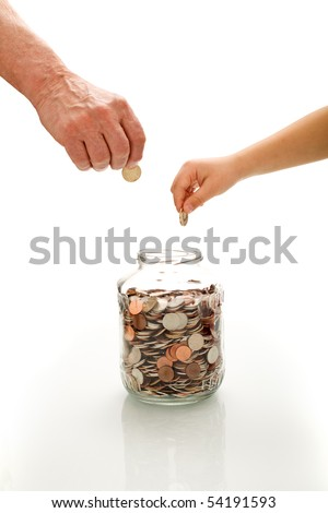 Financial education concept with senior and child hands putting coins in a jar - isolated - stock photo
