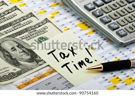 Financial forms with pen, calculator, money and sticker.