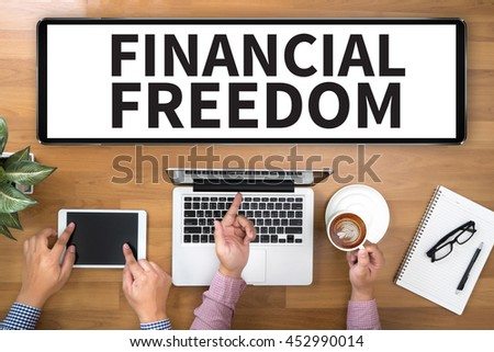 FINANCIAL FREEDOM Two Businessman working at office desk and using a digital touch screen tablet and use computer, top view - stock photo