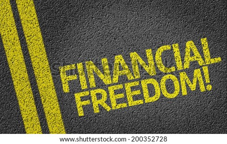 Financial Freedom written on the road - stock photo