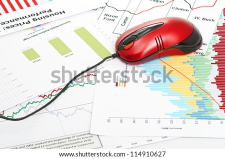 financial graph with computer mouse