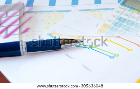 Financial graphs analysis and pen.business Concept