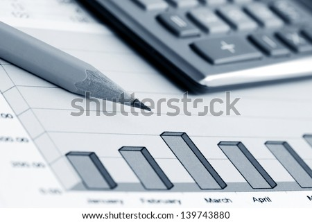 Financial graphs and accounting - stock photo