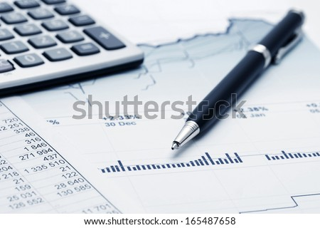 Financial graphs and charts accounting - stock photo