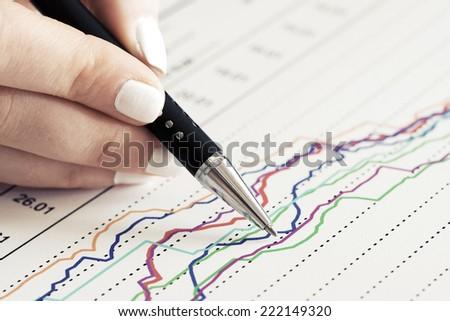 Financial graphs and charts analysis  - stock photo