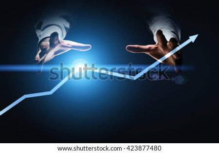 Financial growth concept with businessman hands willing to grab illuminated arrow pointed upwards - stock photo