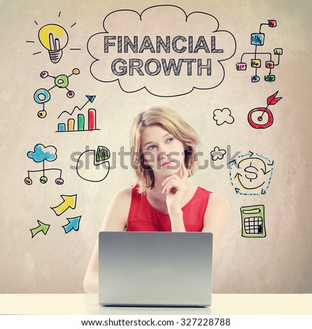 Financial Growth concept with young woman working on a laptop  - stock photo