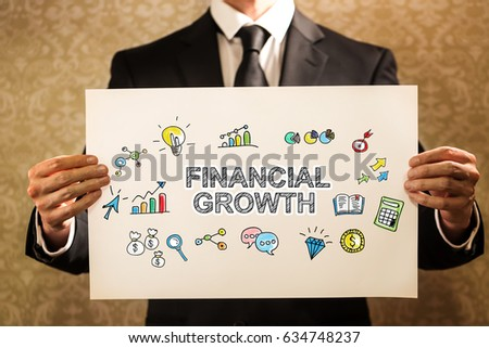 Financial Growth text with businessman holding a sign board