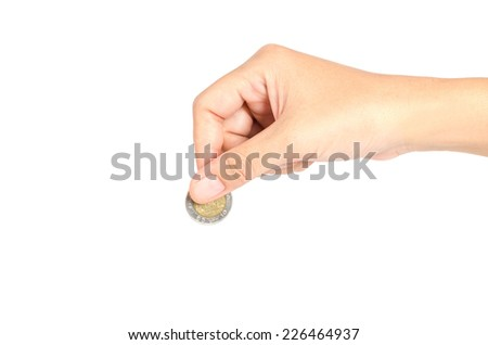Financial Investment concept,Hand putting a coin over white background