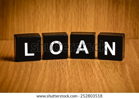financial loan text on black block, business concept - stock photo