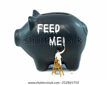 Financial money saving concept on a black piggy bank - stock photo