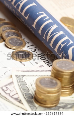 Financial newspaper with paper - stock photo