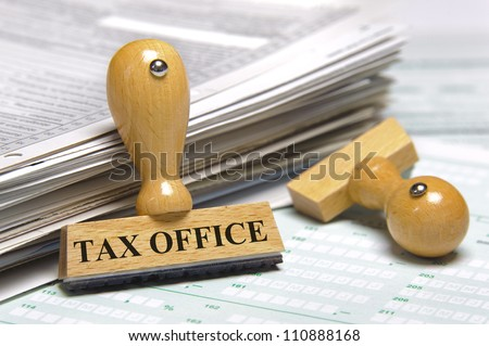 financial paper documents with rubber stamp marked with tax office - stock photo