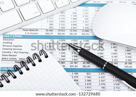 Financial papers, computer and office supplies closeup
