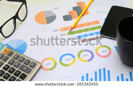 financial paperwork and reports, graph, planning - stock photo