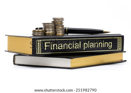 Financial planning book with coins and pen isolated on white background - stock photo