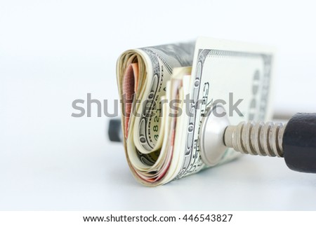 Financial pressure on stock markets concept with stack of dollar bills against clamp