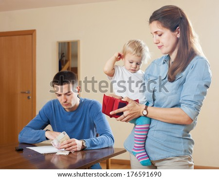Financial problems in the family with baby at home - stock photo