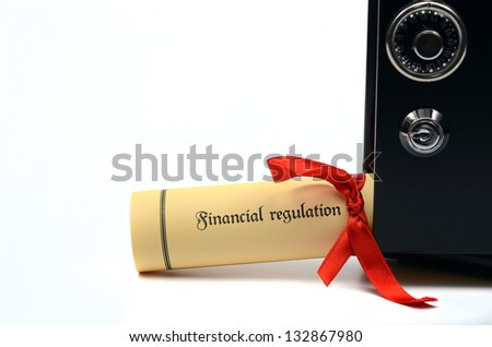 Financial regulation and steel safe on the white backround, Financial regulation concept - stock photo