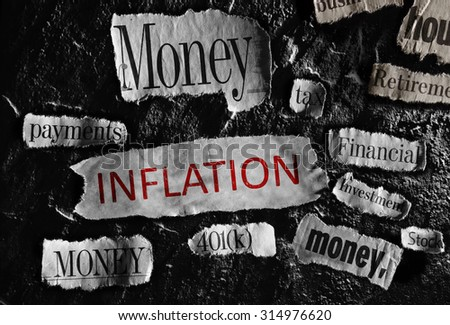 Financial related newspaper headlines with Inflation in red - stock photo