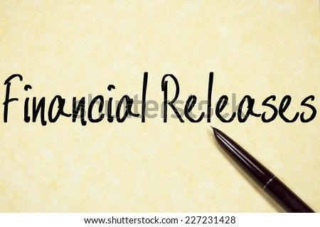 financial releases text write on paper  - stock photo