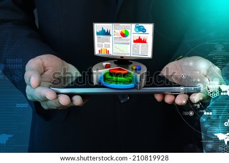 Financial report & statistics on computer - stock photo