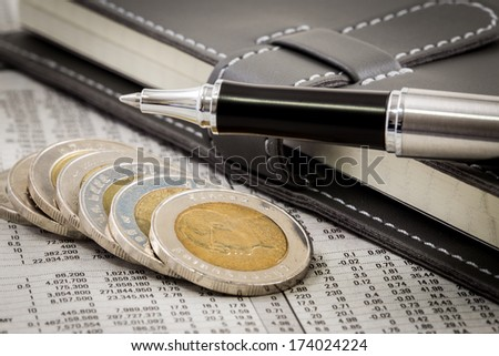 financial report with coins and pen - stock photo