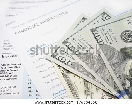 Financial report with dollars banknote