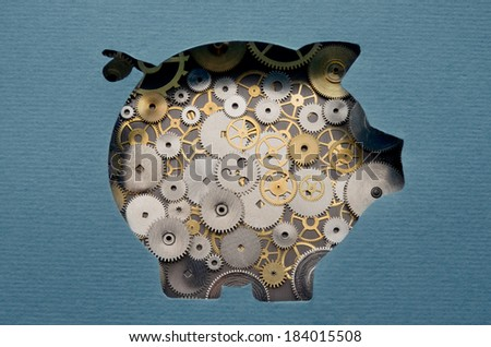 Financial savings mechanism. Piggy bank formed by gears and cogs - stock photo