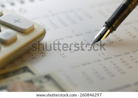 financial settlement date  Calculator with calendar shot with very shallow depth of field