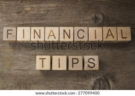 Financial tips text on a wooden background - stock photo
