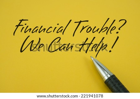 Financial Trouble? We Can Help! note with pen on yellow background - stock photo