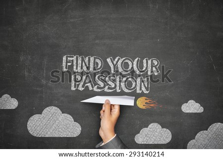 Find your passion concept on black blackboard with businessman hand holding paper plane - stock photo