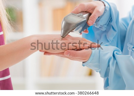 Finding an acupuncture point with electronic device which could be also used to apply lectroacupuncture, PENS - stock photo