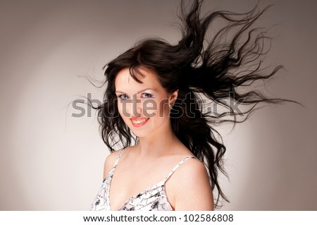 Fine art fashion portrait fashion model posing with hair fluttering in the wind - stock photo